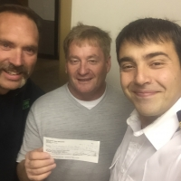 donation-to-Port-McNeill-fire-chief-Tasos-Baroutis